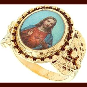 Gold tone encrusted Jesus ring